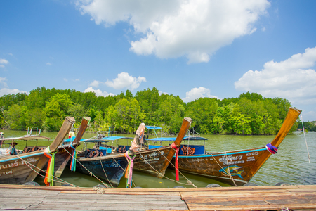 KRABI THAILAND 4 FEB 2018: Longtail boats anchored at the wood port in Krabi Province Thailand. Phi Phi is part of Mu Ko Phi Phi National Park.