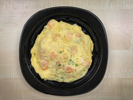 Omelet rice with shrimp in the food container