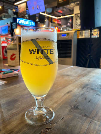 Bangkok Thailand - 25 Nov 2020: A glass of craft beer on table at the beer cap restaurant in Bangkok