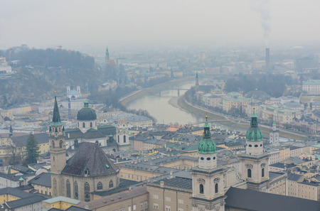AAerial view of beautiful salzburg castle and river during winter and misty condition