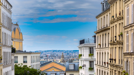 City skyline view as seen from montmartre paris, france during midday Imagens