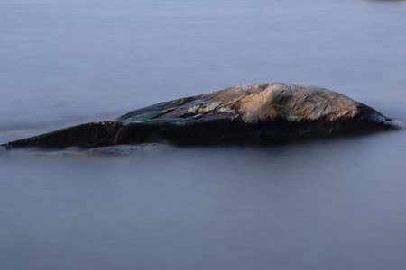 Lone rock in the middle of ocean at gothenburg Sweden Stock Photo