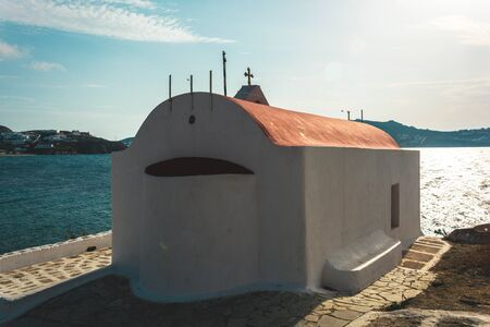 One among the beautiful churches in the town of mykonos Greece bathing in sunshine 스톡 콘텐츠