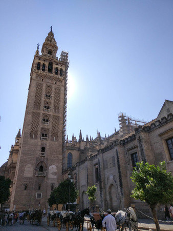 View of the Giralda of Seville next to Seville Cathedral, Photograph taken on clear day without clouds, against light and blue sky - Photograph taken on October 31, 2017, Seville, Andalucia, Spain, Europe