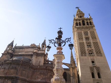 View of the Giralda and the Cathedral of Seville together with the streetlight, Photograph taken on clear day without clouds and blue sky - Photograph taken on October 31, 2017, Seville, Andalucia, Spain, Europe