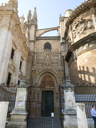 View of one of the entrances of the Cathedral of Seville, Photograph taken on clear day without clouds, against light and blue sky - Photograph taken on October 31, 2017, Seville, Andalucia, Spain, Europe