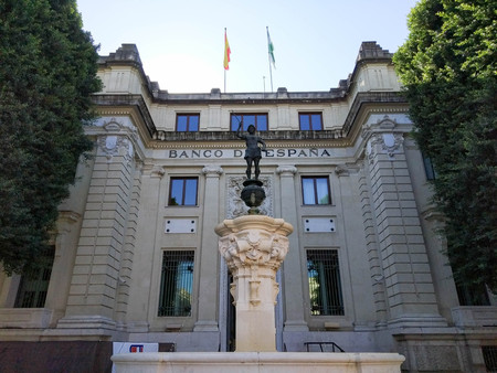 View of the bank of Spain, where the money of all the chorizos of this country is kept. Photograph taken on clear day without clouds, against light and blue sky - Photograph taken on October 31, 2017, Seville, Andalucia, Spain, Europe