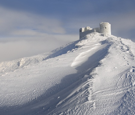 Ancient observatory in the mountains at the winter