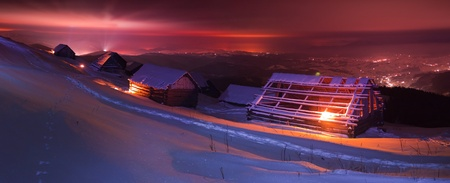 night winter landscape above the ski resort photo