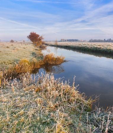 Colorful autumn landscape on the river photo