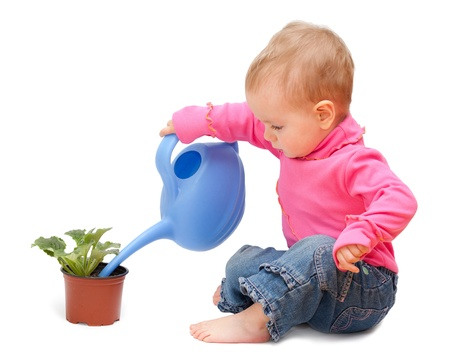 Adorable one-year old baby watering pot with a flower  Isolated on white  photo