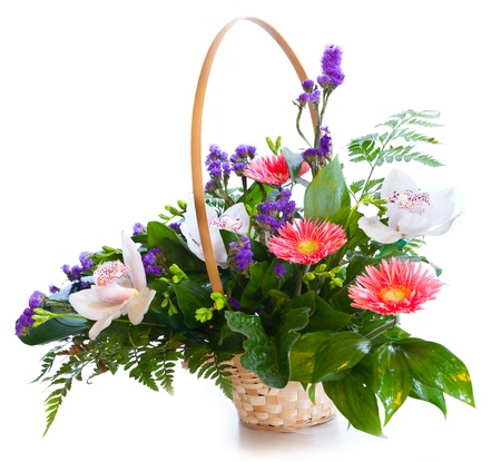 Bright flower bouquet in basket isolated on white photo