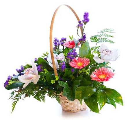 arrangement: Bright flower bouquet in basket isolated on white