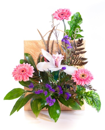 Bright flower bouquet in a basket isolated on white photo