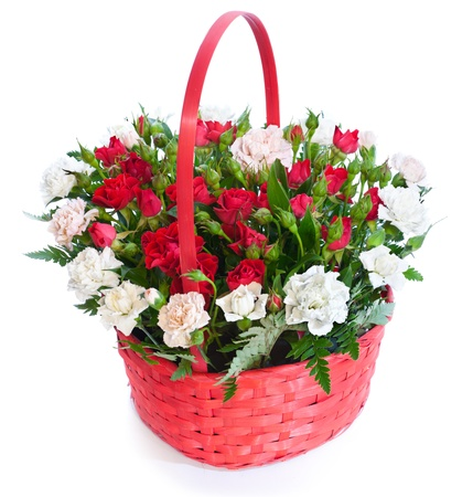 Bright flower bouquet in basket isolated ower white background