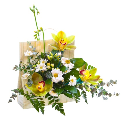 Bright flower bouquet in basket isolated over white background Stock Photo - 13055922