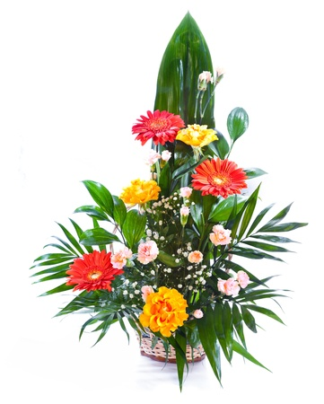 Bright flower bouquet in basket isolated over white background 版權商用圖片