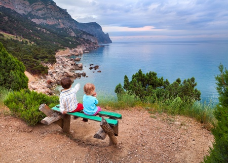 boy and girl on the beach photo