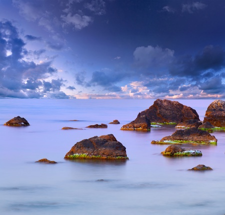 gleam: Colorful summer seascape. Sunset Stock Photo