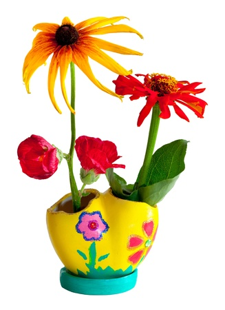 Bright flower bouquet in painted pot isolated on white photo