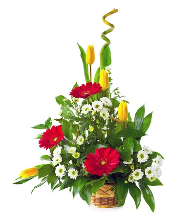 Bright flower bouquet in basket isolated over white background Stock Photo