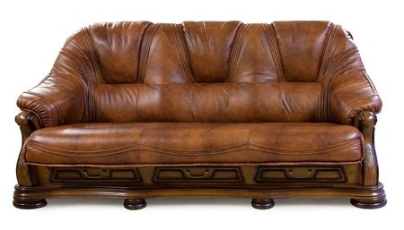 Vintage leather sofa isolated on white photo