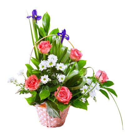 arrangement: Bright flower bouquet in basket isolated over white background Stock Photo