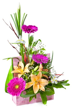 floral arrangement: Bright flower bouquet in basket isolated over white background