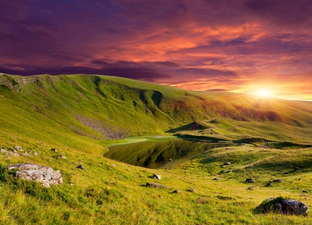 Dramatic summer landscape in the mountains with lake. Sunrise Stock Photo