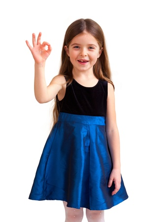 6 year old: cute six year old girl with thumbs up, isolated against white background