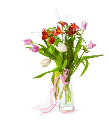 Bright flower bouquet in glass isolated over white background photo