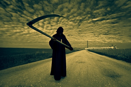 Grim Reaper on the road Stock Photo