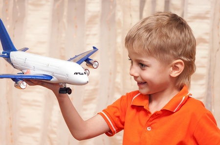 four year old: Adorable four year old boy playing with airplane