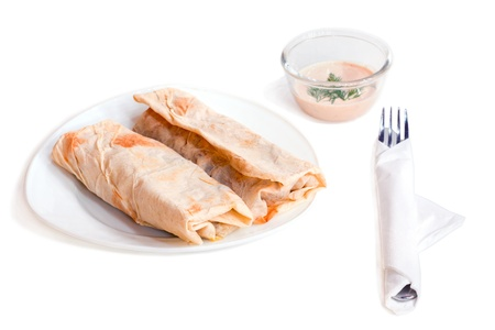 Chicken and vegetables wrapped in a pitta isolated on a white  photo