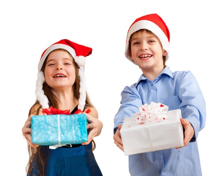 Two cute children give gifts. Isolated on white photo