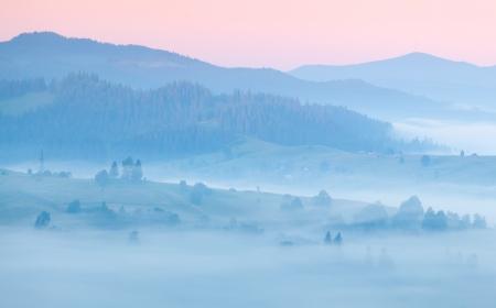 misty morning in the mountains. sunrise photo