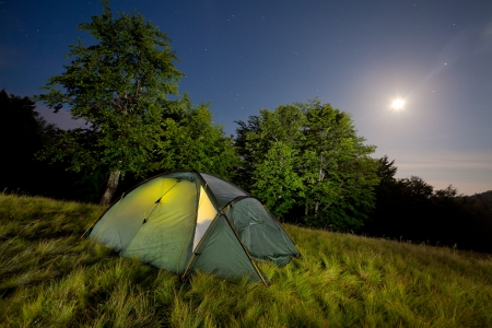 Night view with the tent, moon and the stars Stock Photo - 14387231