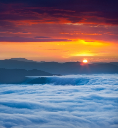 Sunrise over the sea of fog in the mountains at the summer Stock Photo