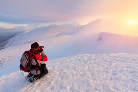 Photographer takes a sunset in the mountains Stock Photo