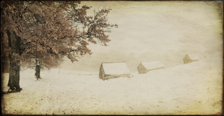 Vintage winter landscape of the old farm  photo