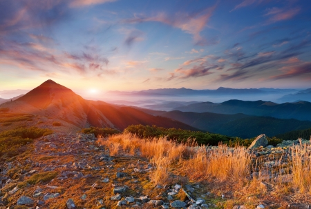 Colorful autumn landscape in the mountains. Sunrise Stock Photo
