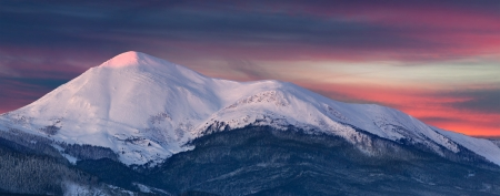 Panorama of snowy summit at winter morning. Petros, Ukraine photo
