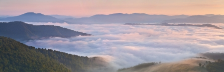 panorama of misty morning in the mountains at the summer photo