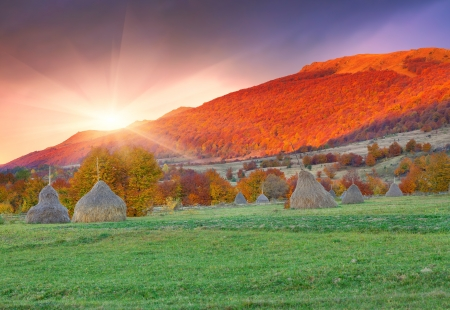 Colorful autumn landscape in the mountains. Sunset photo
