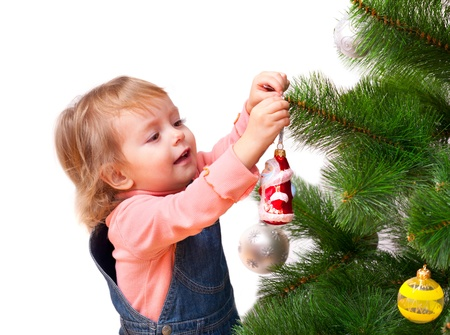 Cute little girl decorates the Christmas tree. Isolated on white Stock Photo - 16422782