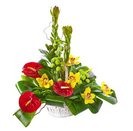 Bright flower bouquet in basket isolated over white background photo