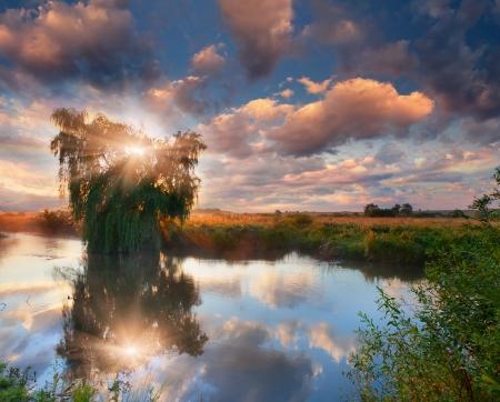 Beautiful summer landscape on the river. Sunrise photo