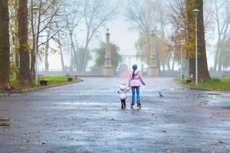 Two sisters walking in the autumn park photo
