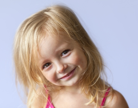 happy little girl a on gray background photo