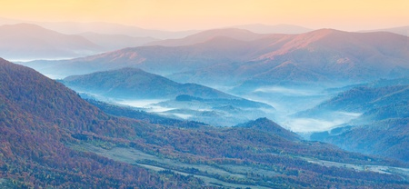 Panorama of the autumn mountains  Foggy mogning 스톡 콘텐츠